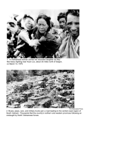 1. A Vietnamese woman carries her wounded daughter as they flee